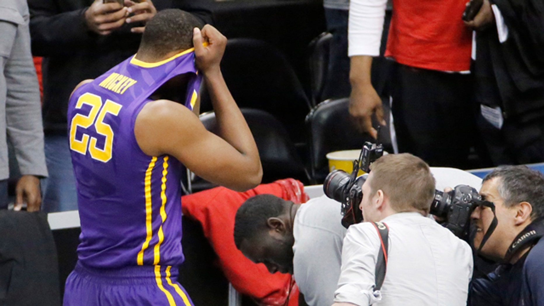 March 19, 2015: LSU's Jordan Mickey (25) leaves the court after his team lost 66-65 to North Carolina State in an NCAA tournament second round  game in Pittsburgh. (AP Photo/Gene J. Puskar)
