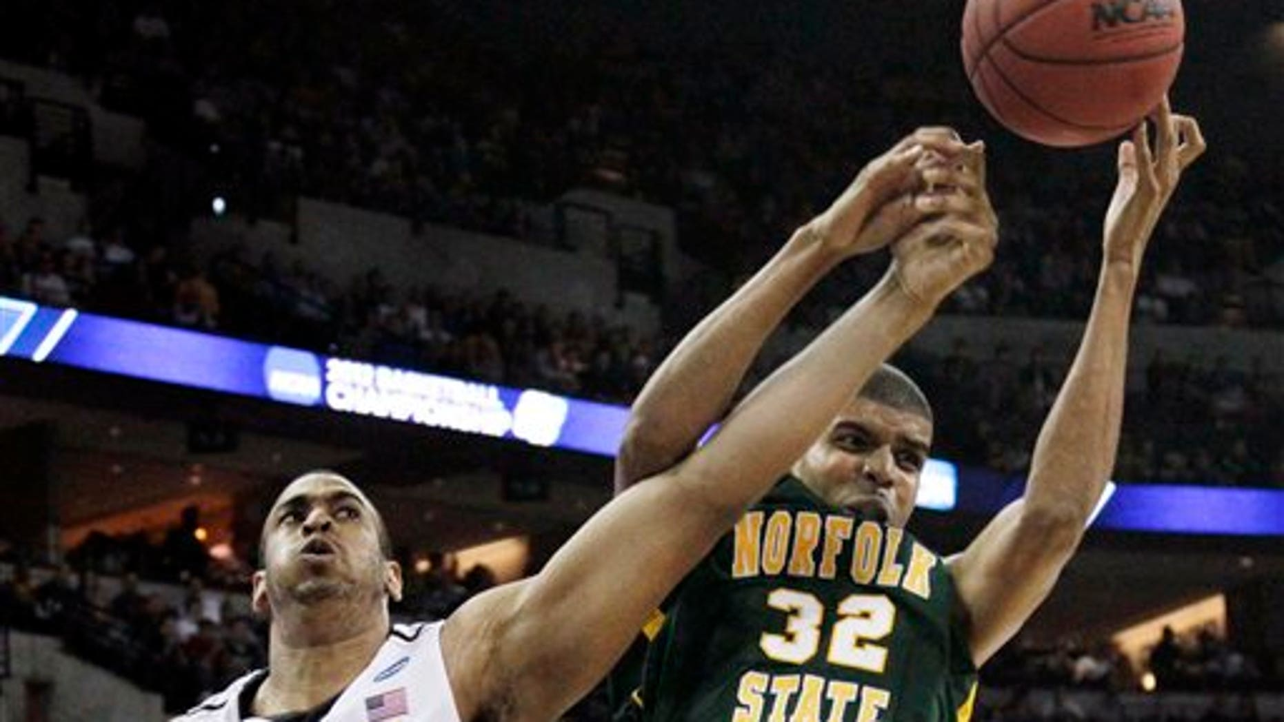 March 16: Missouri center Steve Moore, left, battles for a rebound with Norfolk State forward Marcos Tamares, right, during the first half of an NCAA college basketball tournament game at CenturyLink Center in Omaha, Neb.