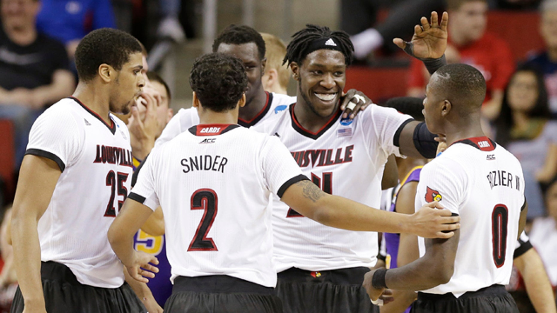 March 22, 2015: Louisville's Montrezl Harrell, second from right, celebrates with teammate Terry Rozier after Harrell dunked against Northern Iowa in the second half of an NCAA tournament college basketball game in the Round of 32 in Seattle. Louisville won 66-53. (AP Photo/Elaine Thompson)