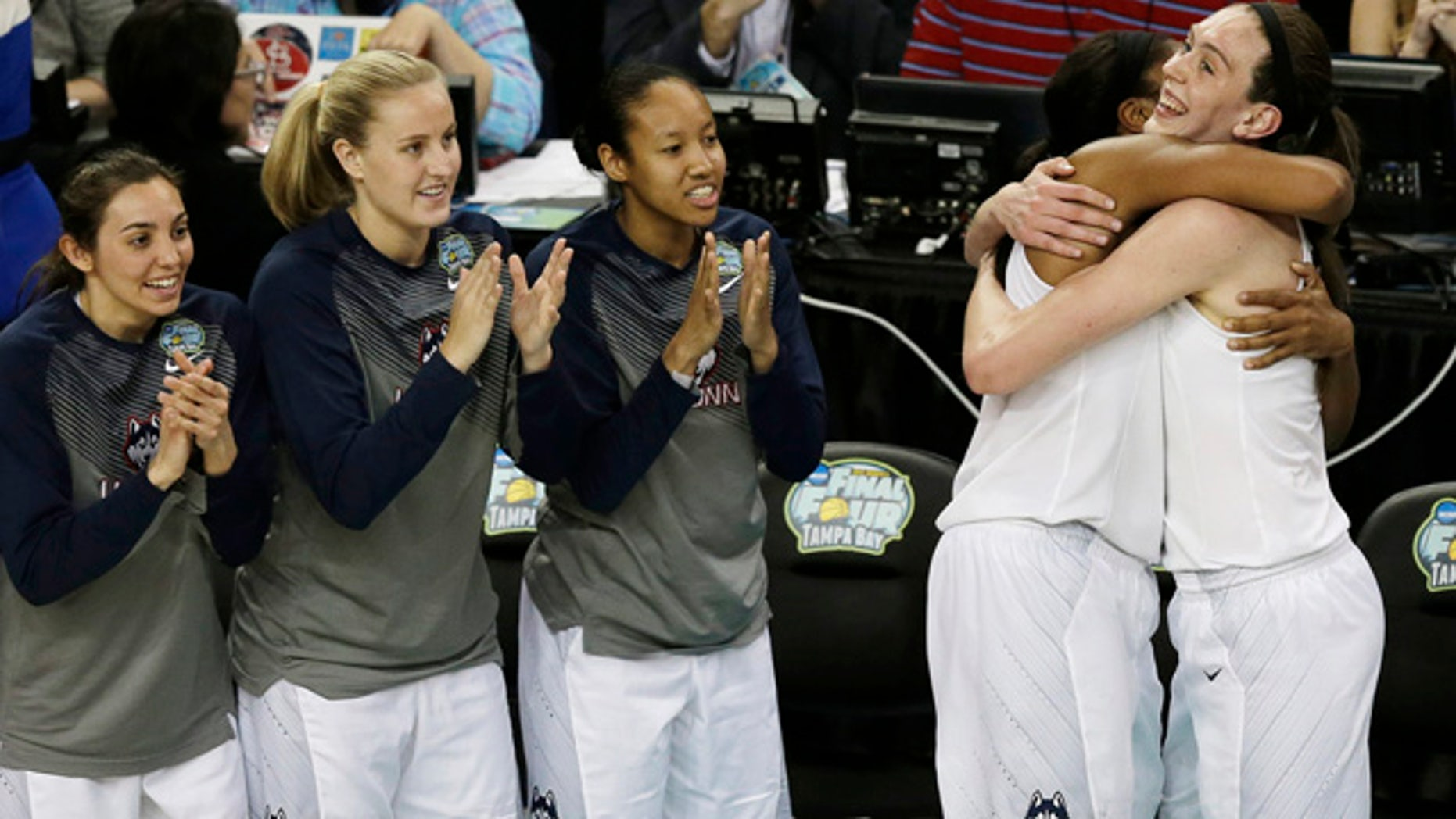 April 7, 2015: Connecticut forward Breanna Stewart (30) and Connecticut forward Morgan Tuck (3) celebrate after the second half of the NCAA women's college basketball championship game against Notre Dame. Connecticut won 63-53. (AP Photo/Chris O'Meara)