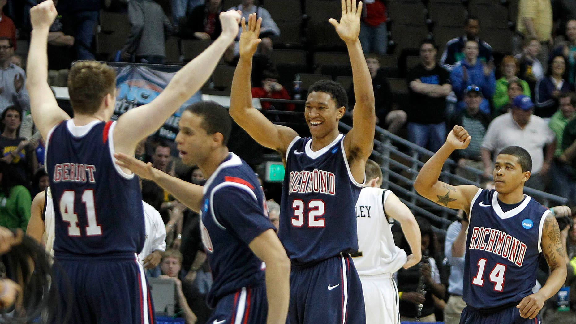 March 17: Richmond's Dan Geriot (41), Justin Harper (32),Francis-Cedric Martel (15) and Kevin Anderson (14) celebrate after their 69-66 win over Vanderbilt in a Southwest regional second round NCAA tournament college basketball game in Denver. (AP)