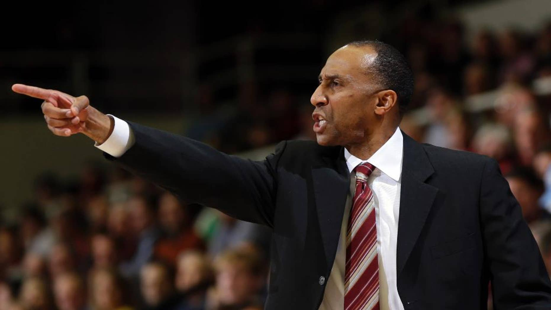 FILE - In this Feb. 20, 2014 file photo, Stanford head coach Johnny Dawkins argues a call during the first half of an NCAA college basketball game against Southern California, in Stanford, Calif. Dawkins is back on college basketball's big stage _ for the first time as a head coach after some special runs as a player.  (AP Photo/Marcio Jose Sanchez, File)