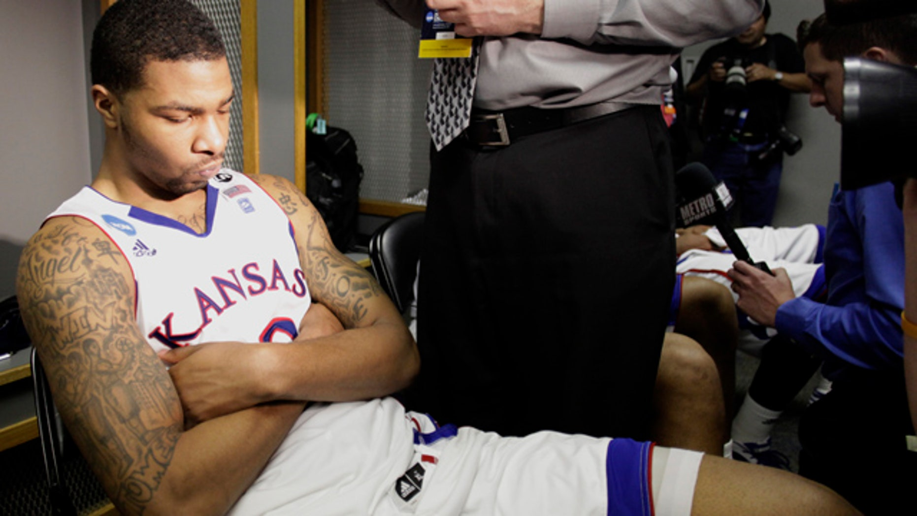 March 27, 2011: Kansas' Elijah Marcus Morris reacts in the locker room after losing 71-61 to Virginia Commonwealth at the Southwest regional final game in the NCAA college basketball tournament.