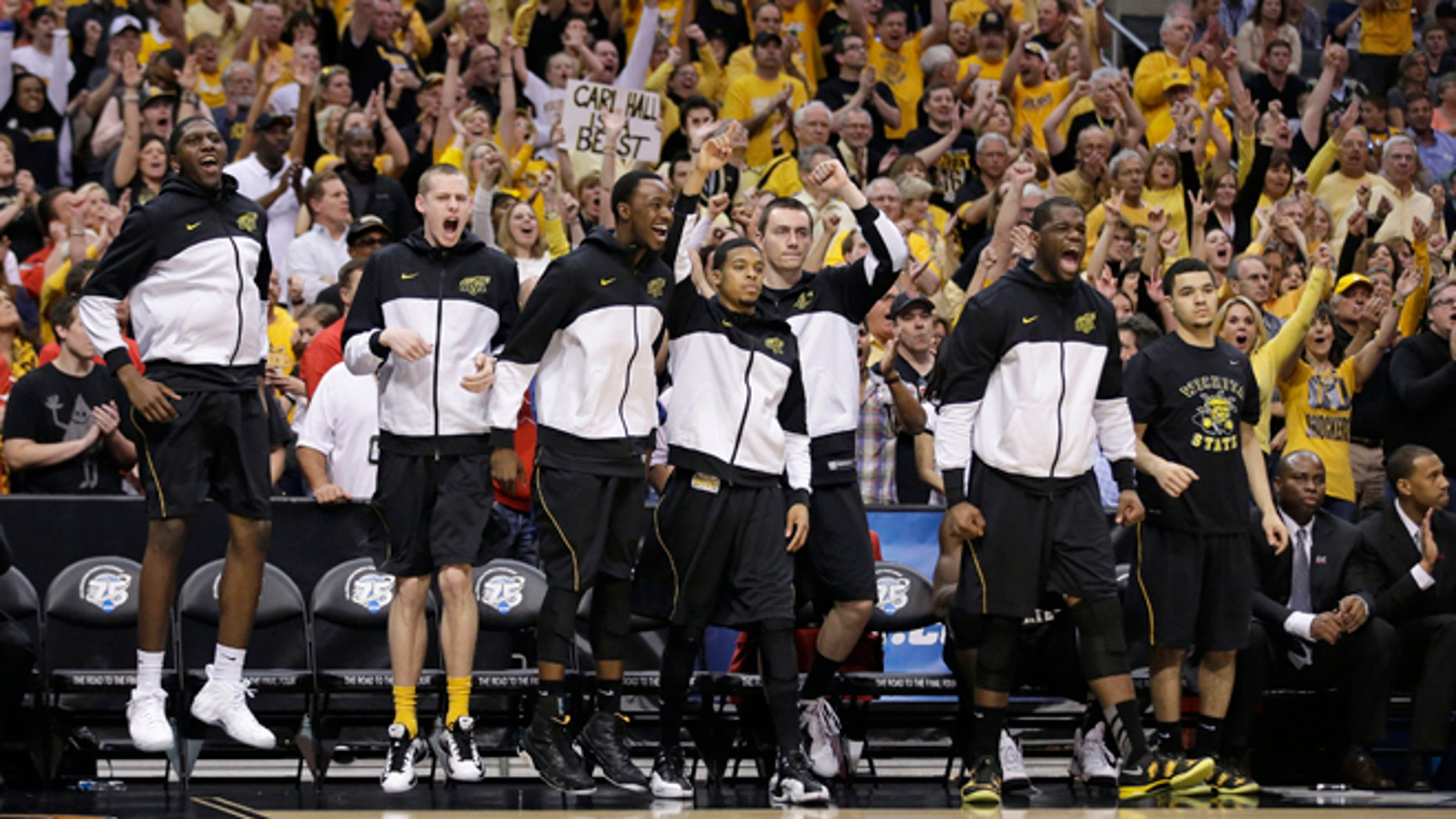 March 30, 2013: Wichita State players react to a field goal scored against Ohio State during the second half of the West Regional final in the NCAA men's college basketball tournament in Los Angeles.