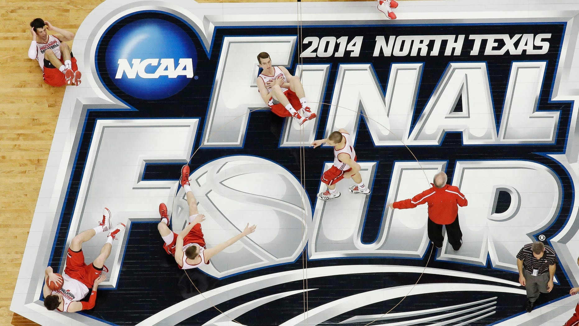 April 4, 2014: Wisconsin players who lost a competition to make the most half-court shots, do sit-ups during practice for their NCAA Final Four tournament college basketball semifinal game in Dallas.
