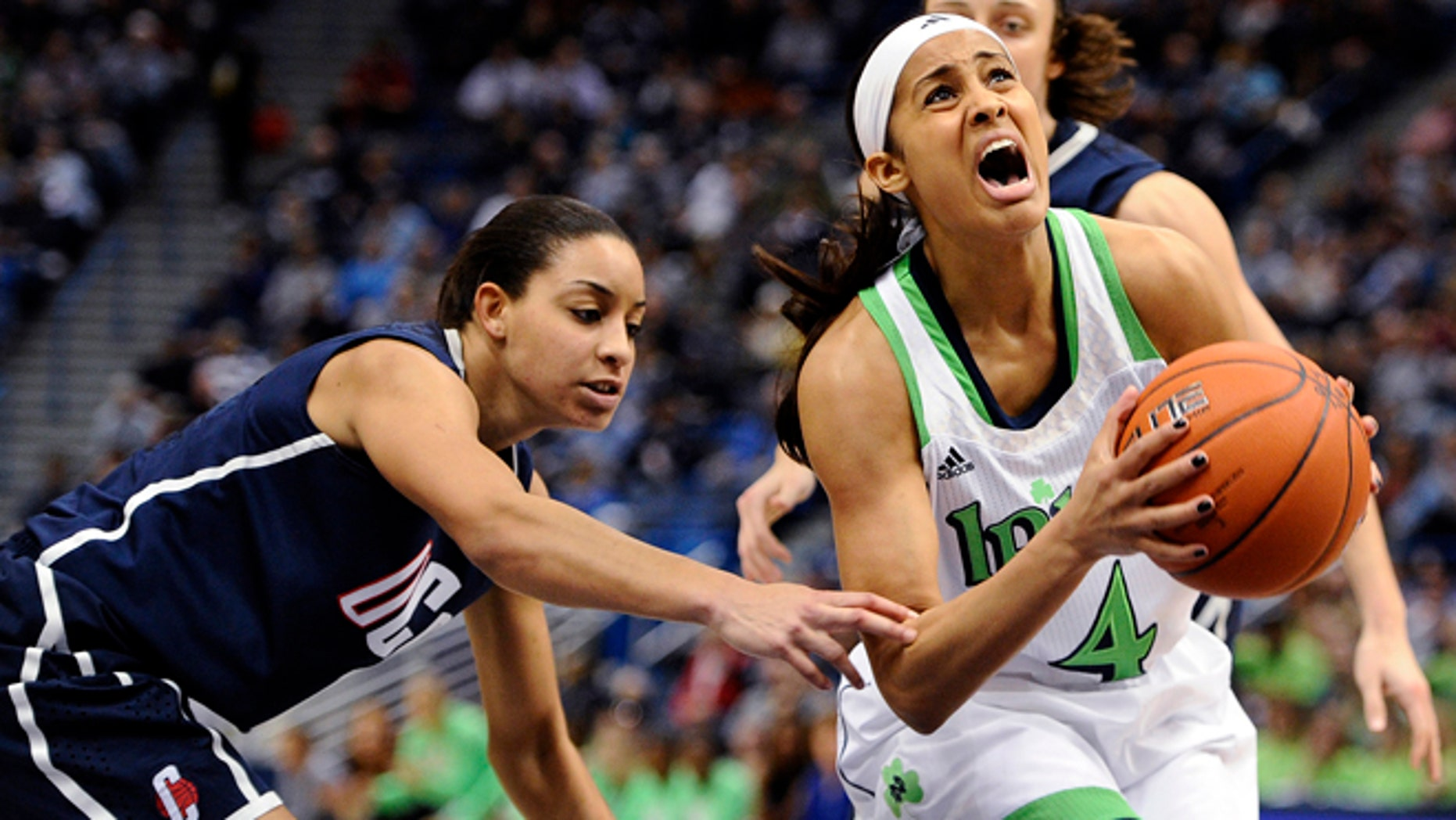 In this March 12, 2013, file photo, Notre Dame's Skylar Diggins (4) is fouled by Connecticut's Bria Hartley, left, in the first half of an NCAA college basketball game in the final of the Big East Conference tournament in Hartford, Conn.