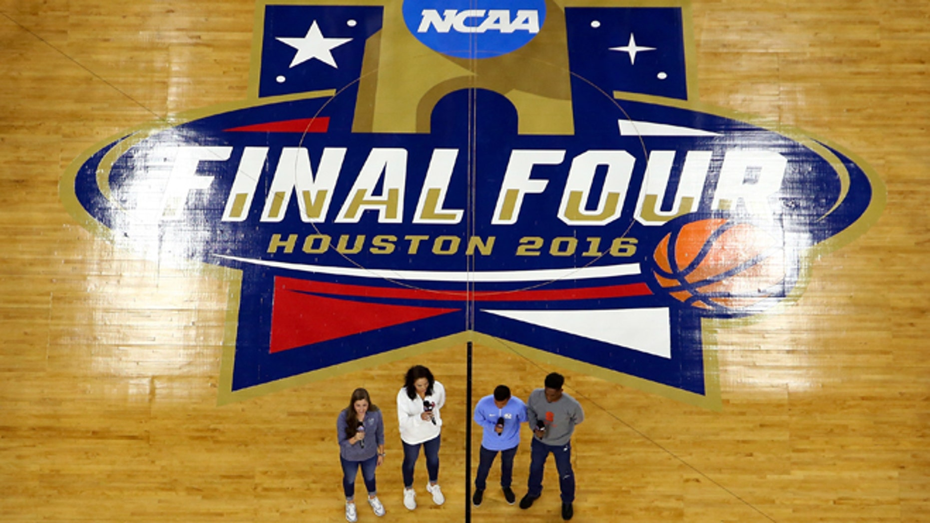 HOUSTON, TEXAS - APRIL 02:  (L-R) Villanova Wildcats womenâs basketball player Karlie Crispin, Oklahoma Sooners womenâs volleyball player Madison Ward, North Carolina Tar Heels menâs soccer player Nico Melo, and Syracuse Orange menâs track and field athlete Chevis Armstead II perform the national anthem prior to the NCAA Men's Final Four Semifinal between the Villanova Wildcats and the Oklahoma Sooners at NRG Stadium on April 2, 2016 in Houston, Texas.  (Photo by Streeter Lecka/Getty Images)