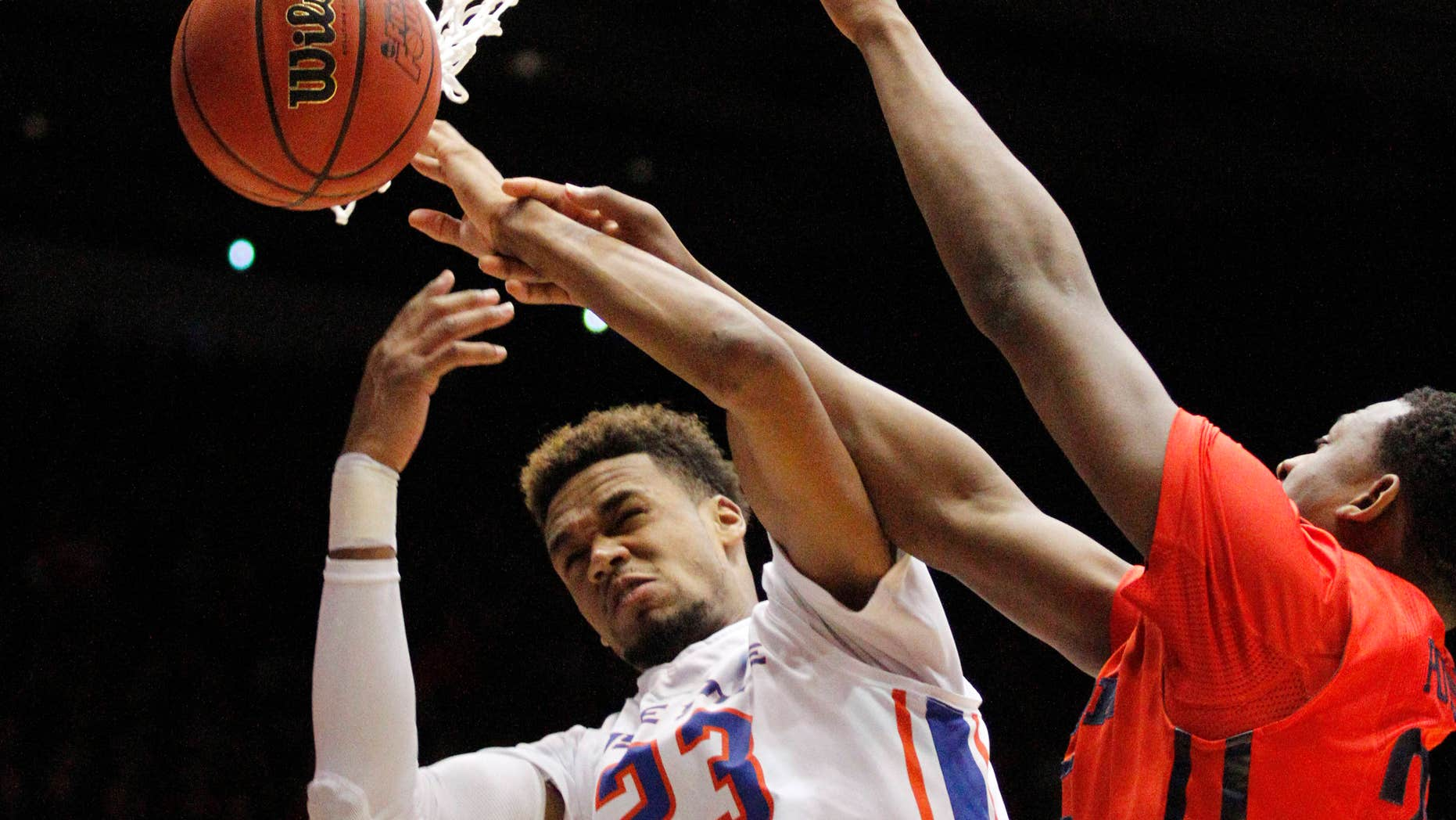 March 18, 2015: Boise State's James Webb III (23) is hit by Dayton's Kendall Pollard in the first half of a first round NCAA tournament basketball game.