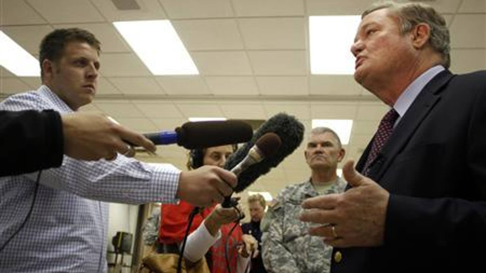 North Dakota Governor Jack Dalrymple (R) speaks with the media at the FEMA Disaster Recovery Center in Minot, North Dakota, June 27, 2011. REUTERS/Allen Fredrickson