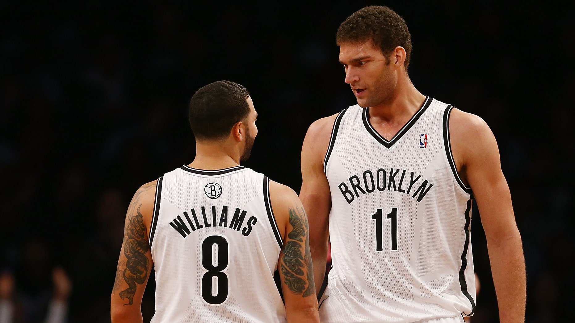 NEW YORK, NY - NOVEMBER 03: Brook Lopez #11 of the Brooklyn Nets speaks with teammate Deron Williams #8 during a game against the Toronto Raptors at the Barclays Center on November 3, 2012 in the Brooklyn borough of New York City. NOTE TO USER: User expressly acknowledges and agrees that, by downloading and/or using this photograph, user is consenting to the terms and conditions of the Getty Images License Agreement.  (Photo by Alex Trautwig/Getty Images)
