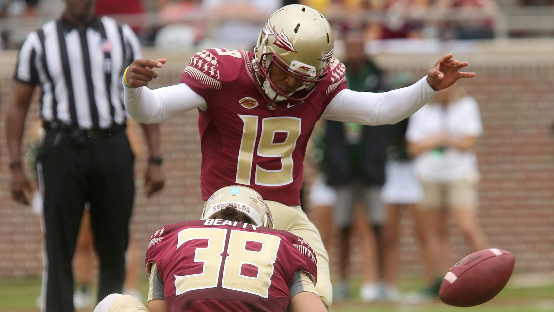 FILE - In this Sept. 12, 2015, file photo, Florida State's Roberto Aguayo kicks an extra point from the hold of Cason Beatty during an NCAA college football game against South Florida in Tallahassee, Fla. Aguayo, who is the most accurate kicker in NCAA history, could be the first kicker in 10 years to be selected in the first three rounds of the NFL Draft.  (AP Photo/Steve Cannon, File)