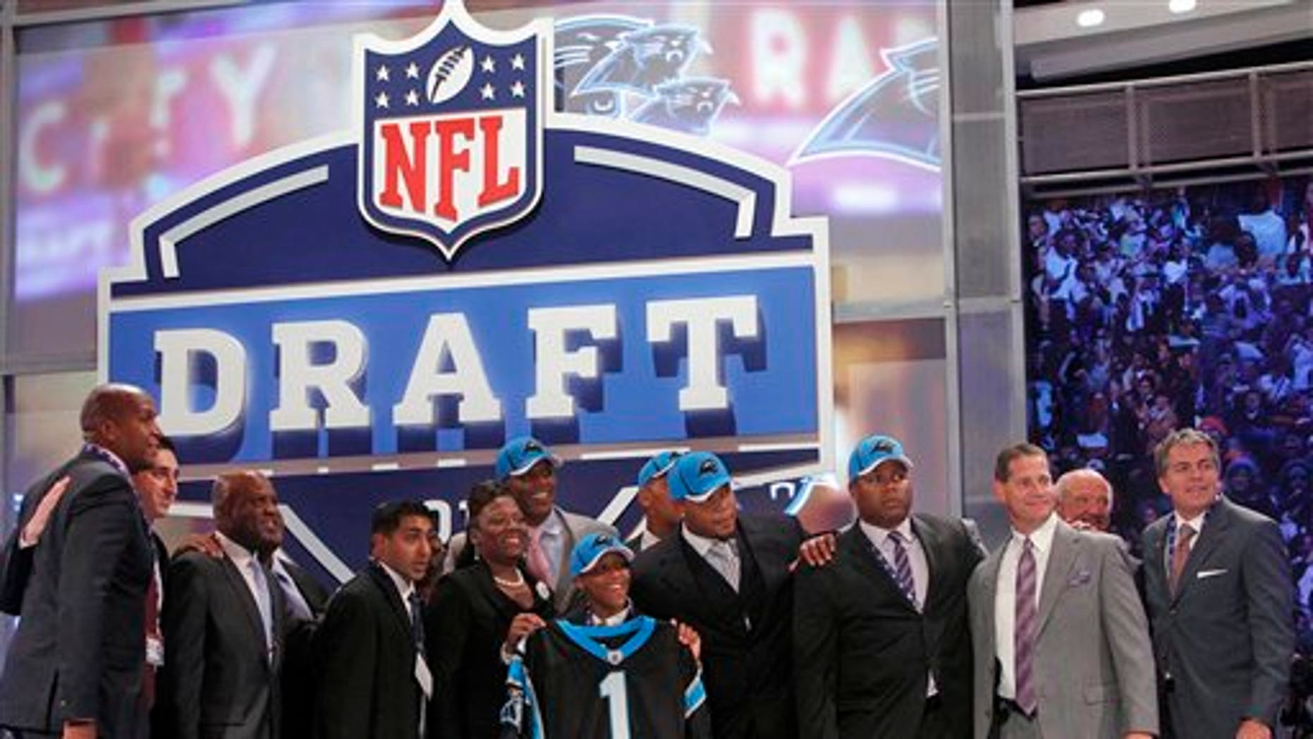 April 28: Auburn quarterback Cam Newton, rear center, poses with family and friends including Auburn coach Gene Chizik, third from right, after he was selected as the No. 1 overall by the Carolina Panthers in the first round of the NFL football draft at Radio City Music Hall in New York. (AP)
