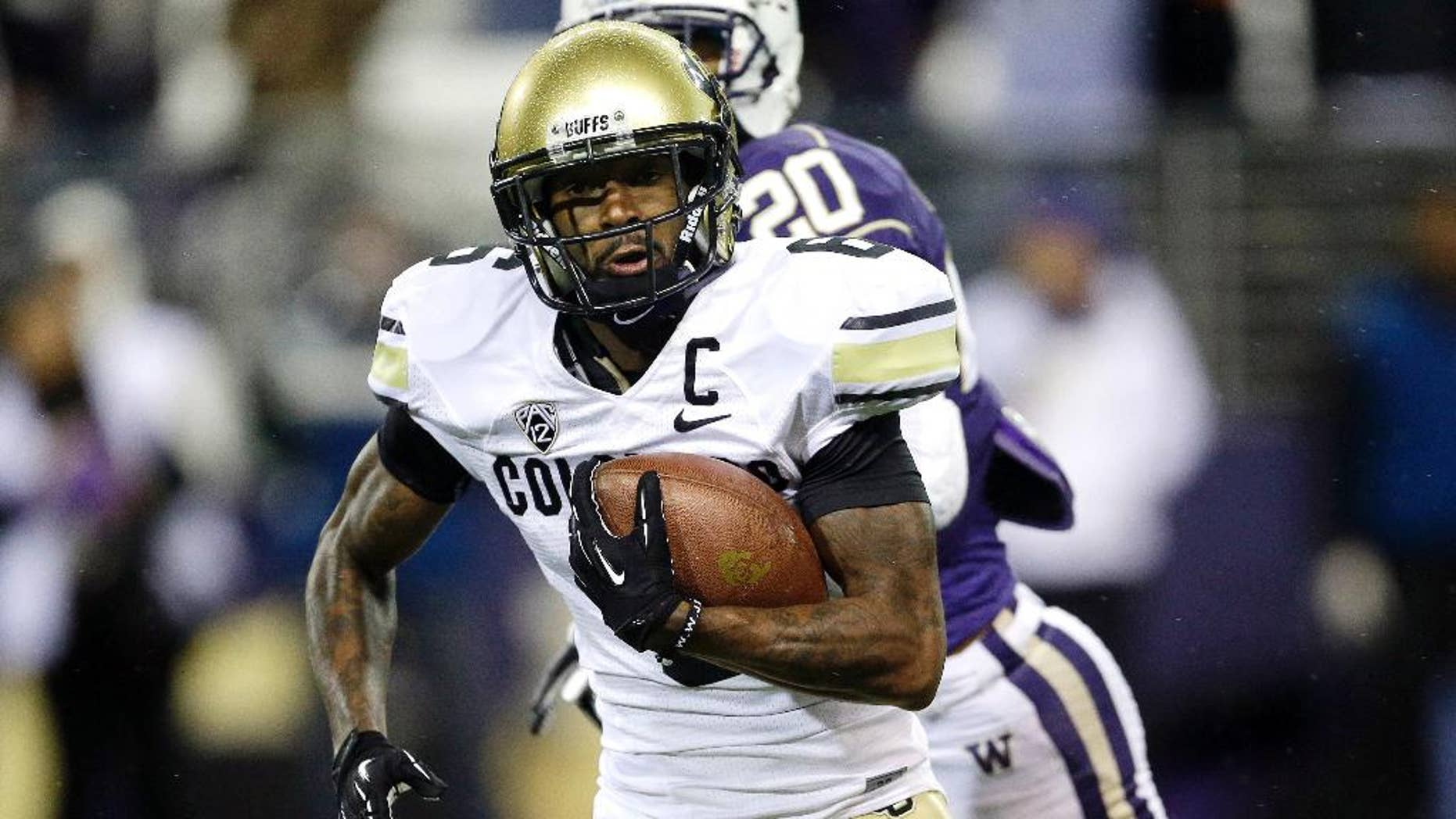 FILE - In this Nov. 9, 2013, file photo, Colorado's wide receiver Paul Richardson runs the ball for a touchdown after making a reception against Washington in the first half of an NCAA college football game in Seattle. The Seattle Seahawks picked Colorado wide receiver Richardson with the No. 45 overall pick in the second round of the NFL draft Friday, May 9, 2014. (AP Photo/Ted S. Warren, File)