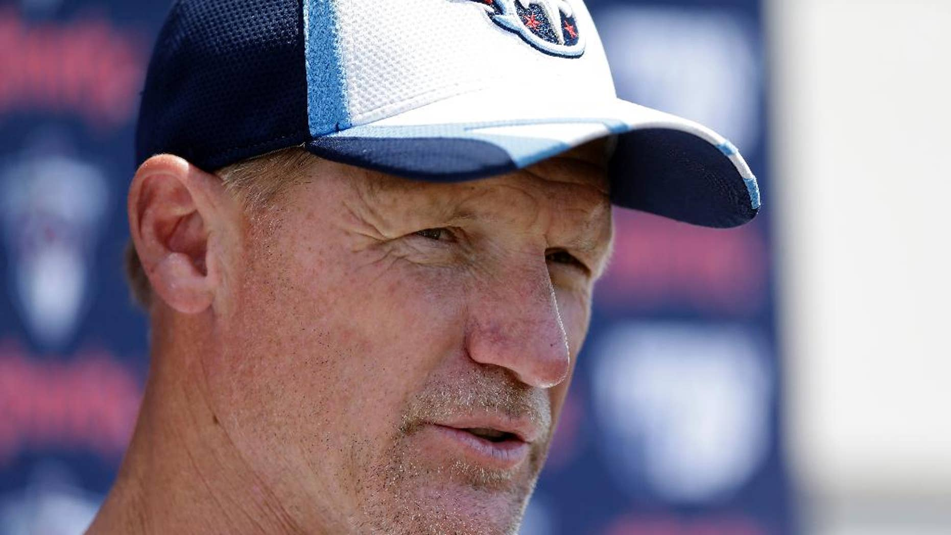 ADVANCE FOR WEEKEND EDITIONS, OCT. 18-19 - FILE -  In this July 26, 2014, file photo, Tennessee Titans head coach Ken Whisenhunt answers questions during NFL football training camp in Nashville, Tenn. The Titans (2-4) have two games left before their bye, and two wins would get them back to .500 at 4-4. So first-year coach Whisenhunt has dangled a bit of a carrot for his Titans, according to some of his players. (AP Photo/Mark Humphrey, File)