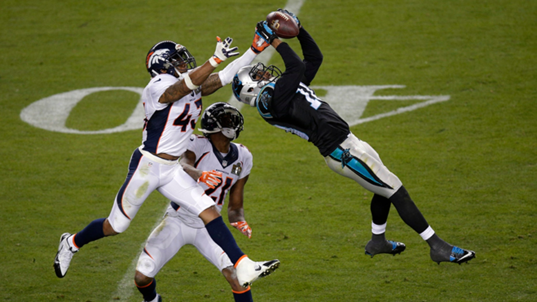 FILE - In this Feb. 7, 2016, file photo, Carolina Panthers' Corey Brown (10) catches a pass in front of Denver Broncos' T.J. Ward (43) and Aqib Talib (21) during the NFL Super Bowl 50 football game in Santa Clara, Calif. The NFL season will begin the way the last one ended, with the Broncos playing the Panthers. Denver beat Carolina 24-10 in February in the Super Bowl, Peyton Manning's final game. The rematch will be on Thursday night, Sept. 8 in Denver. (AP Photo/Charlie Riedel, File)