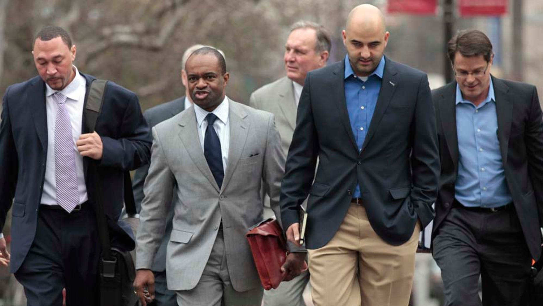 NFL Players Association (NFLPA) Executive Director DeMaurice Smith, second from left, flanked by Pittsburgh Steelers Charlie Batch, left, NFLPA spokesman George Atallah, second from right, and others, arrive for the first negotiating session involving a federal mediator, Friday, Feb. 18, 2011, in Washington. (AP Photo/Alex Brandon)