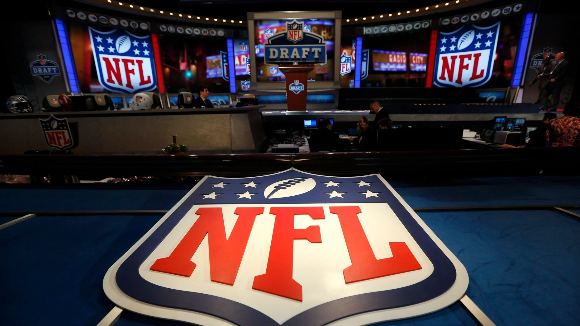 File photo - The NFL logo and set are seen at New York's Radio City Music Hall before the start of the 2013 NFL Draft April 25, 2013.