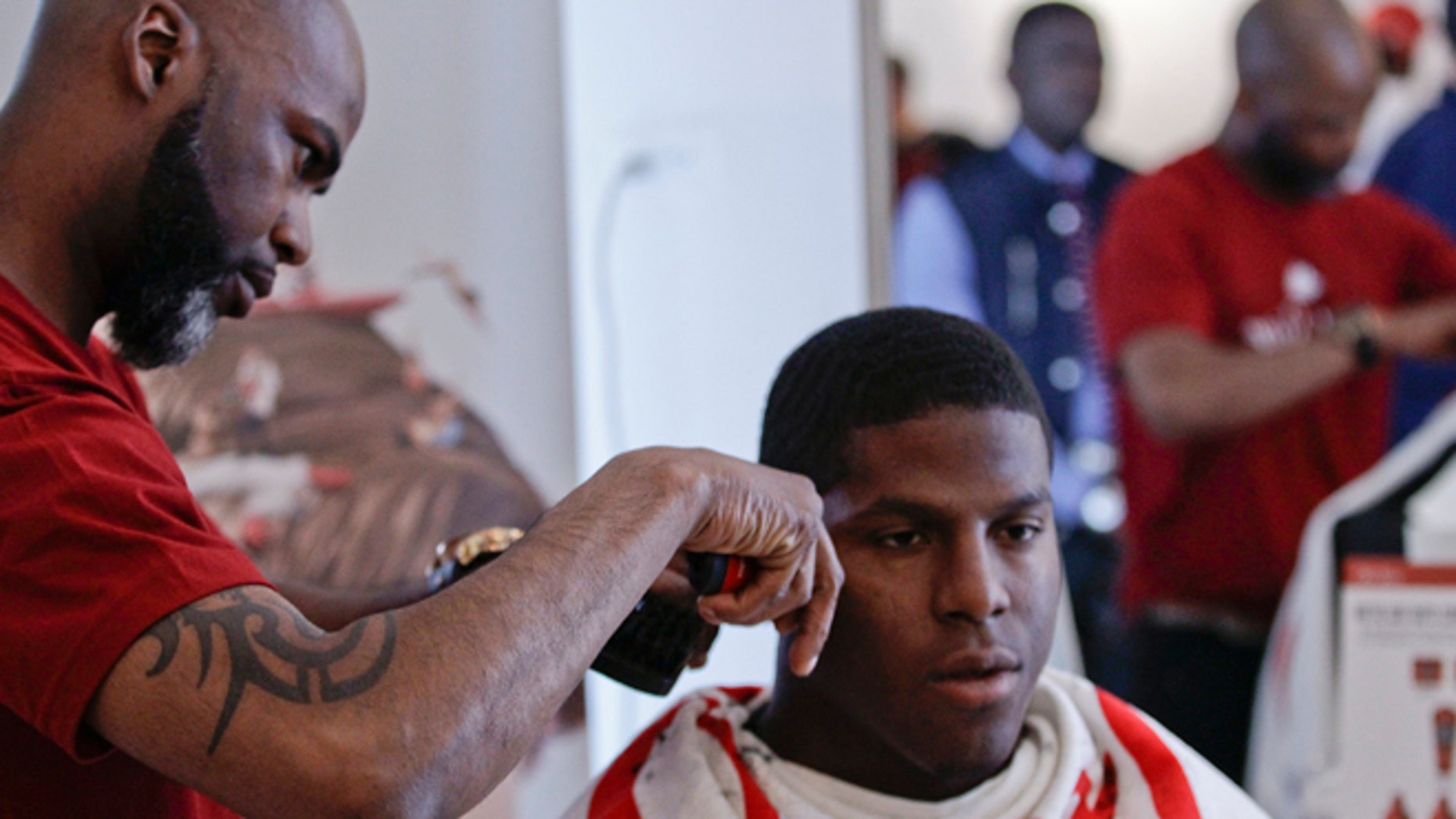 This May 6, 2014 photo shows NFL Draft prospect Kony Ealy, a defensive end from Missouri, getting a haircut during the 5th Annual NFL Pre-Draft Gifting & Style Suite at the Sean John showroom in New York. Ealy is among dozens of prospects on the  National Football League's annual draft, with 32 players per round and seven rounds, beginning Thursday night at Radio City. Ealy is projected to go late in the first round. (AP/Frank Franklin II)
