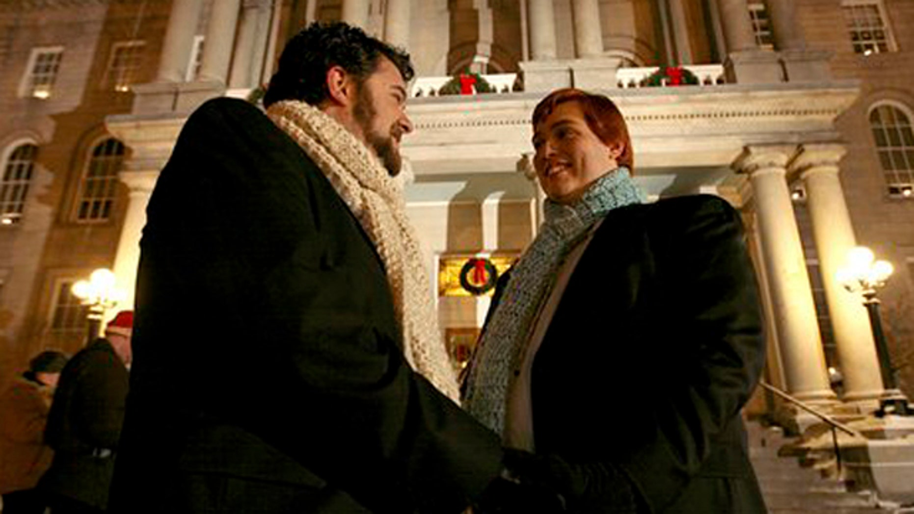 FILE - Bill Gaudet, left, and Ramon Gaudet, right, wait to be wed in front of New Hampshire's Statehouse  in Concord, N.H.