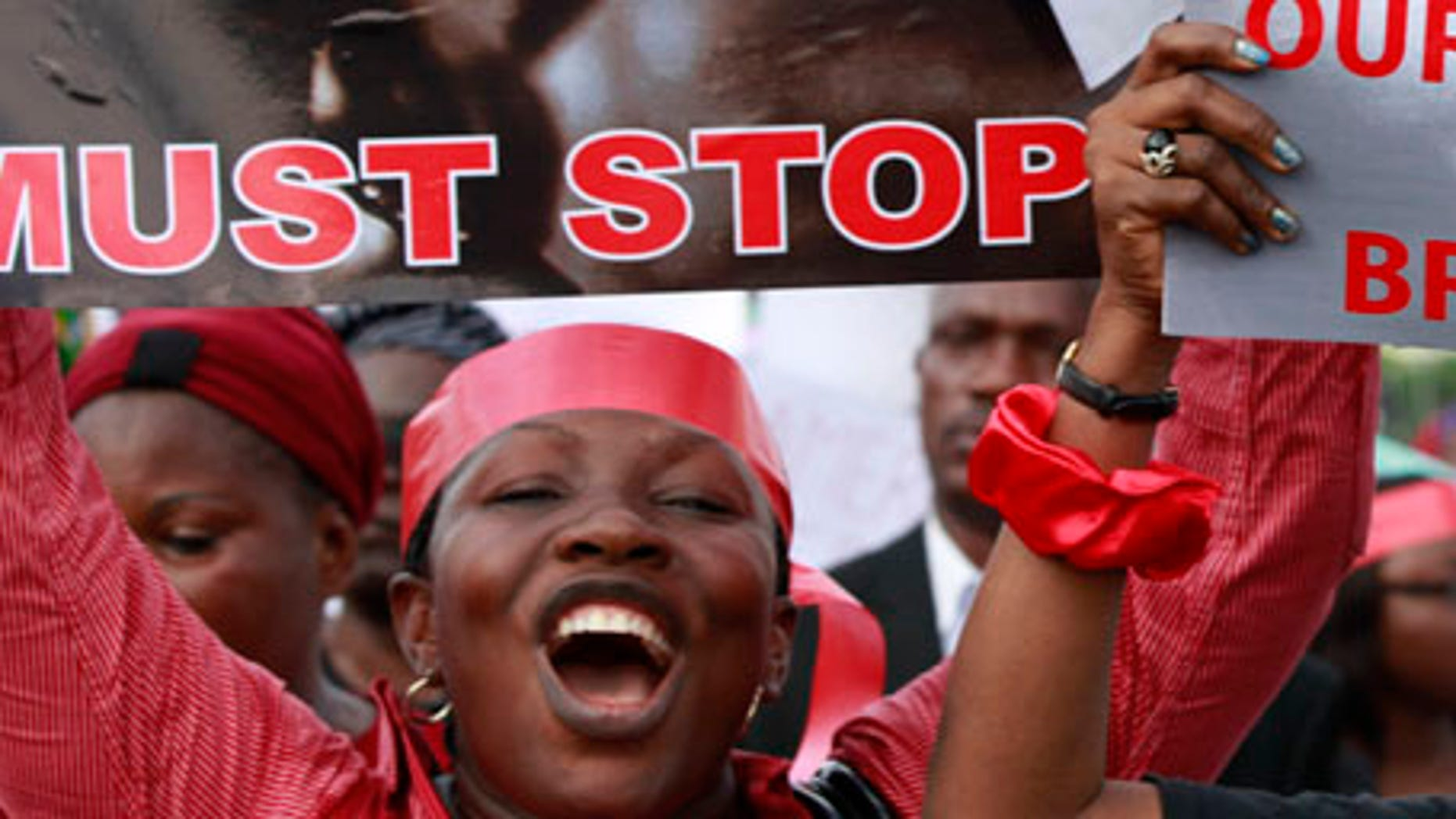 """Women attend a demonstration calling on the government to rescue kidnapped school girls of a government secondary school Chibok, in Lagos, Nigeria, Monday May 5, 2014. Their plight  and the failure of the Nigerian military to find them  has drawn international attention to an escalating Islamic extremist insurrection that has killed more than 1,500 so far this year. Boko Haram, the name means """"Western education is sinful,"""" has claimed responsibility for the mass kidnapping and threatened to sell the girls. The claim was made in a video seen Monday. The British and U.S. governments have expressed concern over the fate of the missing students, and protests have erupted in major Nigerian cities and in New York. (AP Photo/Sunday Alamba)"""