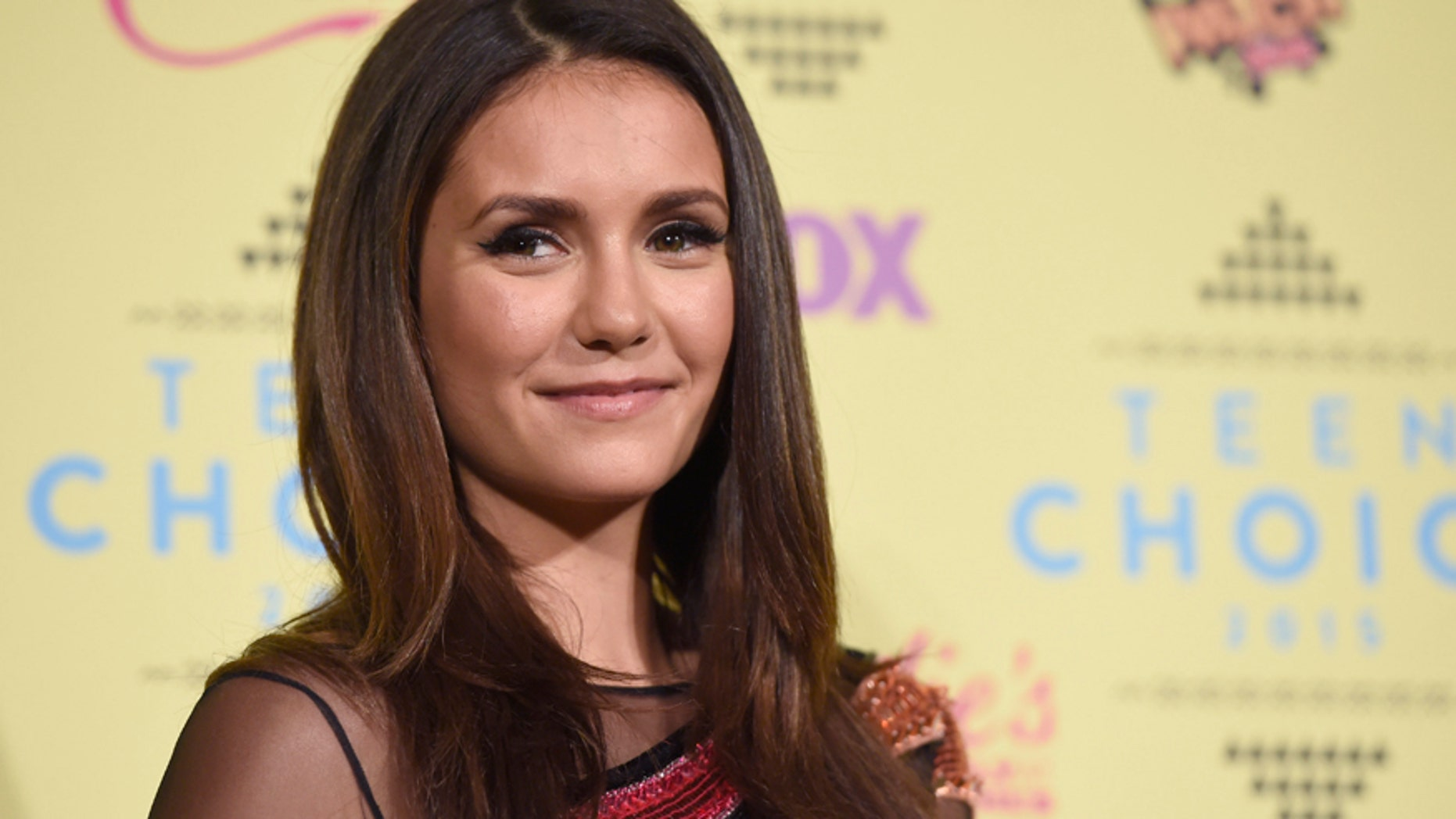 Nina Dobrev, winner of the choice TV  actress: sci-fi fantasy award for The Vampire Diaries, poses in the press room at the Teen Choice Awards at the Galen Center on Sunday, Aug. 16, 2015, in Los Angeles. (Photo by Chris Pizzello/Invision/AP)