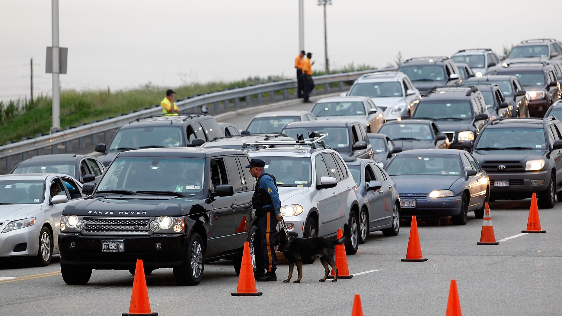 EAST RUTHERFORD, NJ - SEPTEMBER 11:  K-9 State Troopers and stadium security inspect cars with dogs as they enter the stadium for the NFL season opener between the New York Jets and Dallas Cowboys at MetLife Stadium on September 11, 2011 in East Rutherford, New Jersey. Extra security is in place at the stadium due to the 10 year anniversary of the 9/11 terror attacks.  (Photo by Jeff Zelevansky/Getty Images)