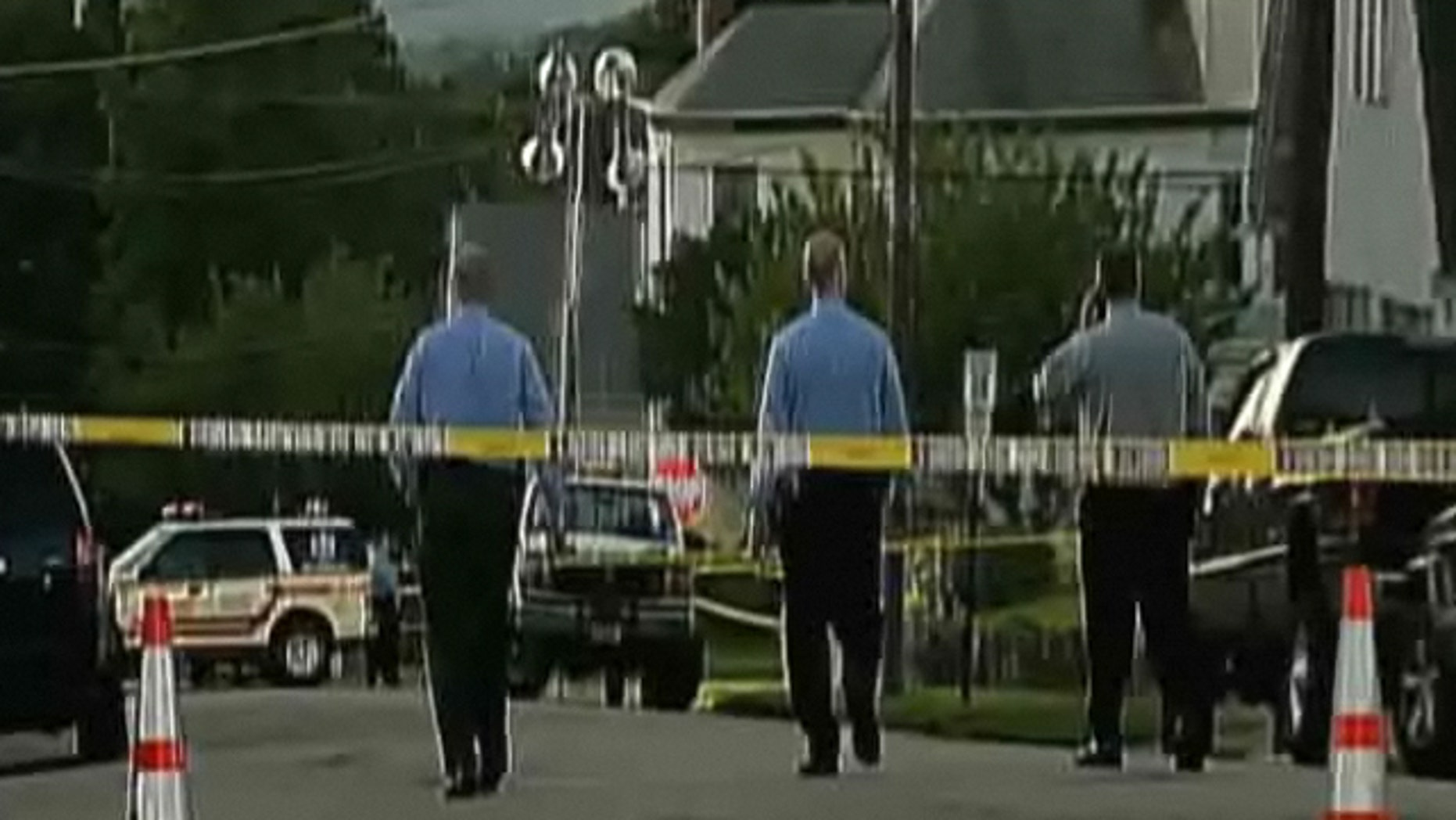 New Jersey police inspect the scene of a shooting that claimed the life of a woman.