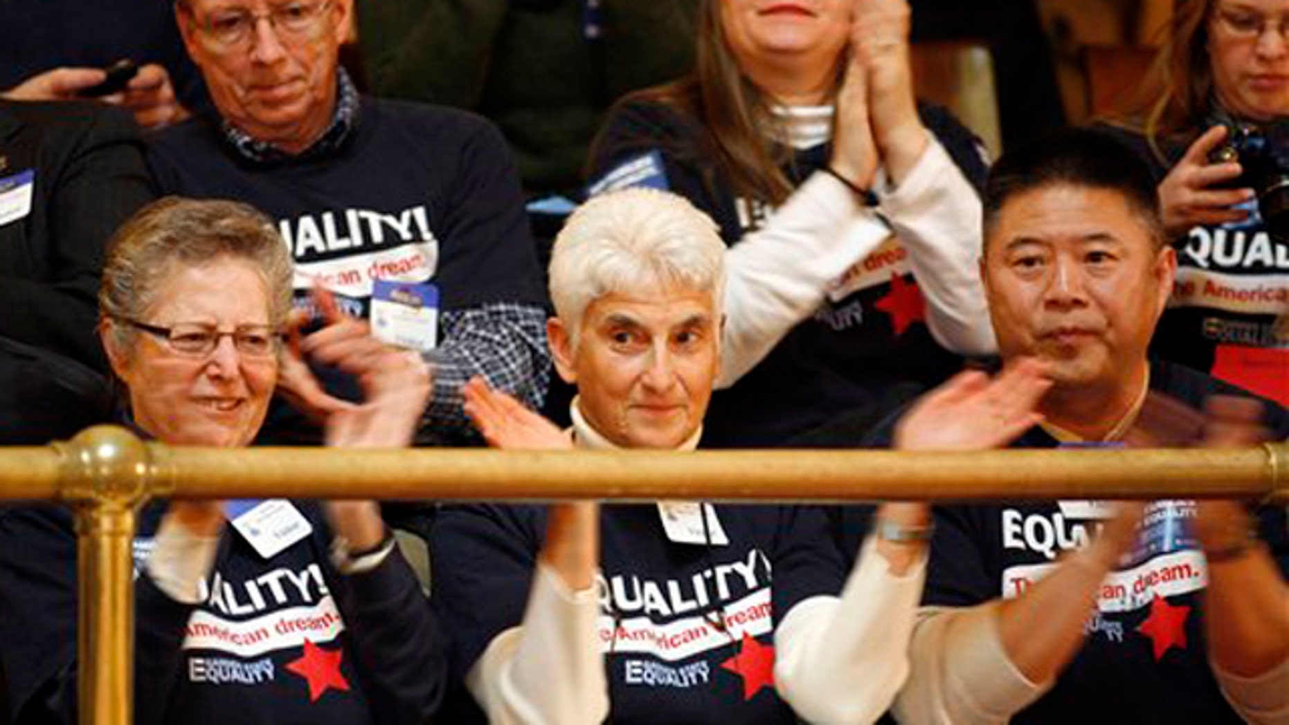 Feb. 13, 2012: Spectators in the balcony applaud the passage of the bill in the New Jersey State Senate recognizing same-sex marriages by a vote of 24-16, in Trenton, N.J.