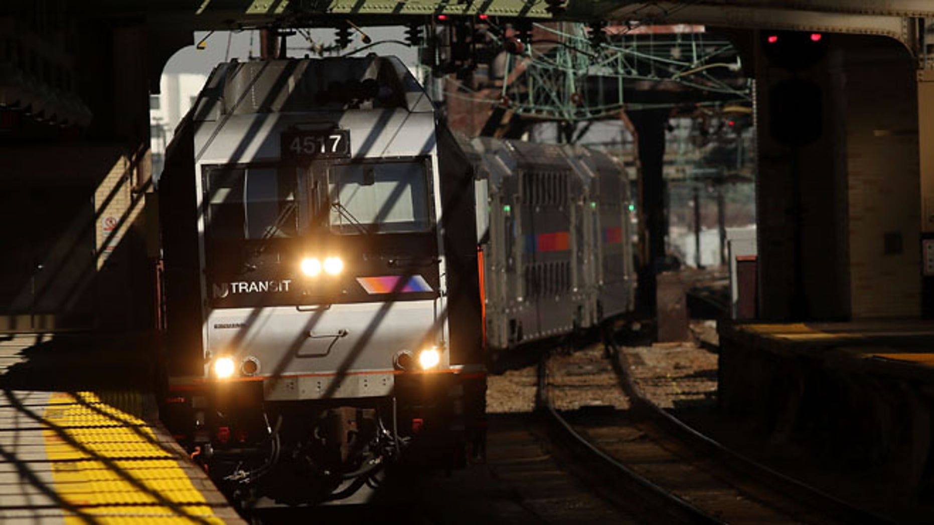 NEWARK, NJ - MARCH 09: A NJ Transit train pulls into a station as a strike looms on one of the nations most popular commuter lines on March 9, 2016 in Newark, New Jersey. The employee unions, which have been without a contract since 2011, are threatening to strike , will resume talks with management on Thursday while a strike could take place as early as Monday morning. (Photo by Spencer Platt/Getty Images)