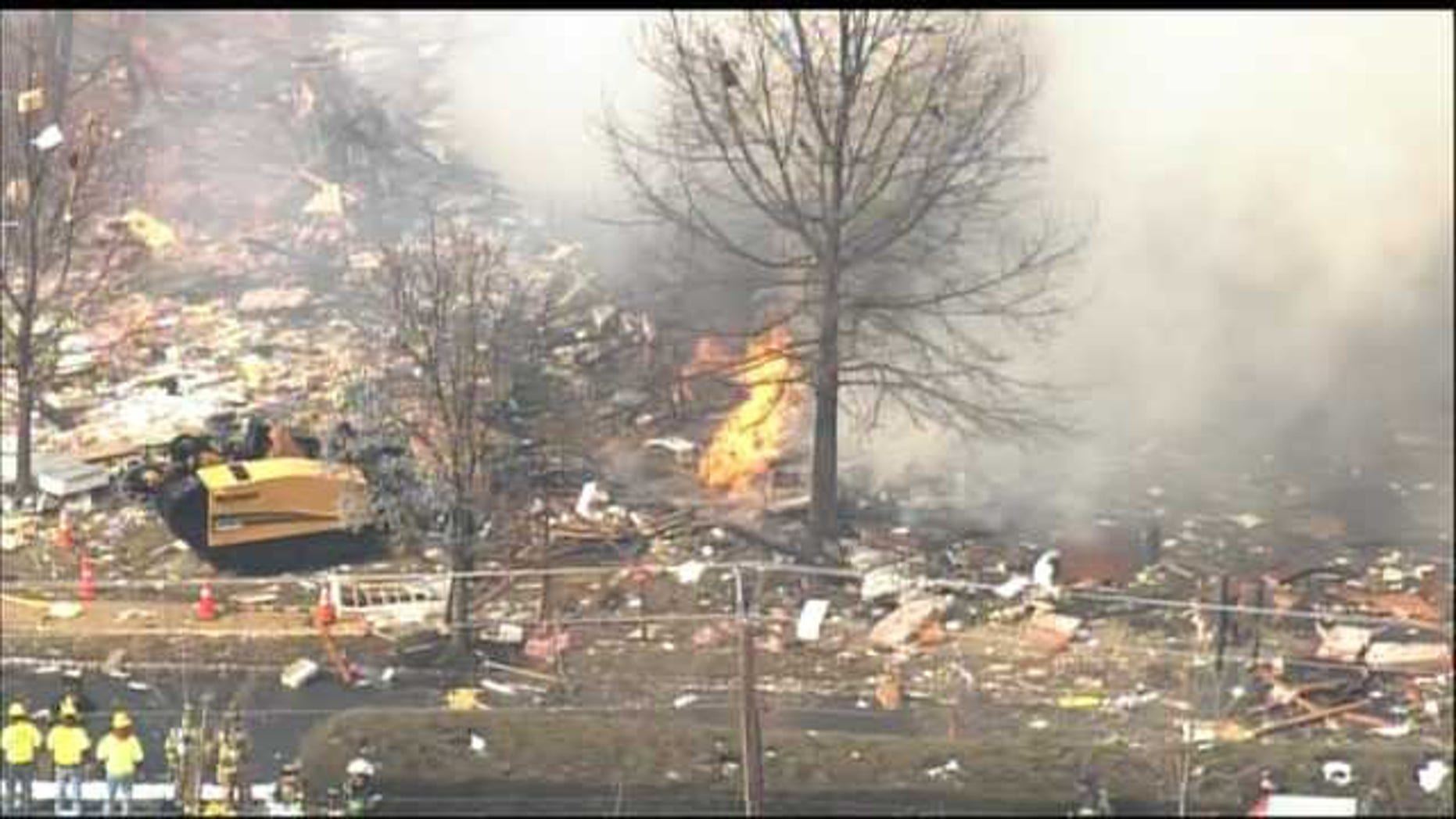 "March 4, 2014: This aerial photo shows the aftermath of an explosion at a townhouse complex in Ewing, N.J. A gas line damaged by a contractor exploded ""like a bomb"" while utility crews worked to repair it Tuesday at the complex, killing one woman and injuring seven people while several homes were destroyed or damaged. (MyFoxPhilly.com)"