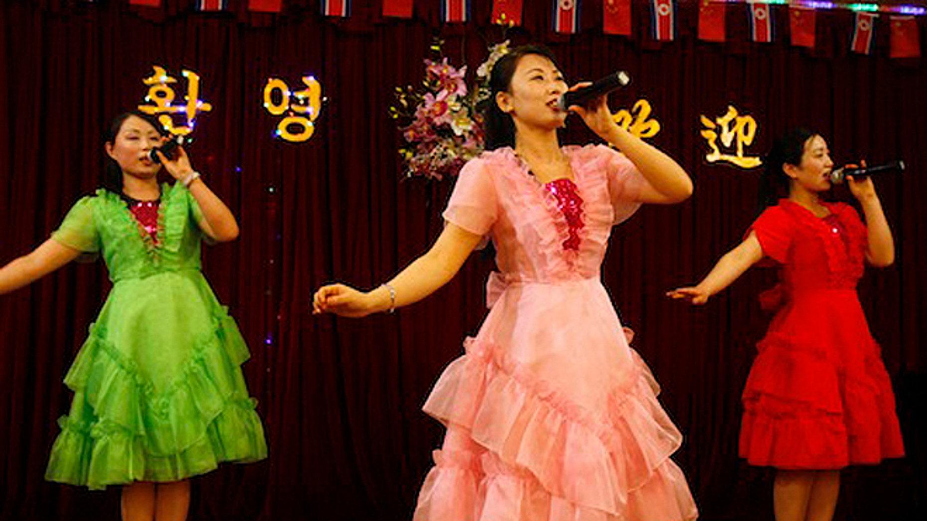 North Korean women sing at a North Korean restaurant in Dandong, China. (AP)