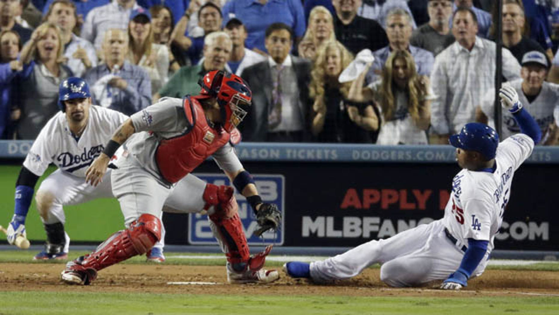 October 14, 2013: Carl Crawford slides safely past St. Louis Cardinals catcher Yadier Molina during the eighth inning of Game 3 of the National League baseball championship series Monday in Los Angeles. (AP Photo/Chris Carlson)