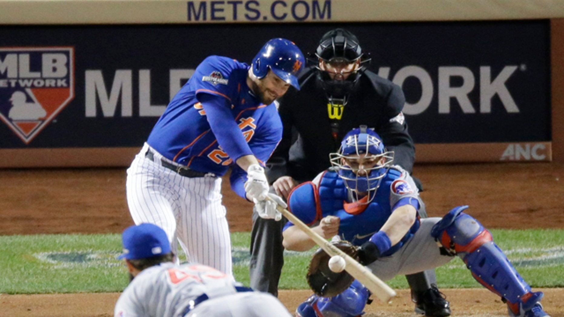 Oct. 18, 2015: New York Mets' Daniel Murphy hits a two-run home run during the first inning of Game 2 of the National League baseball championship series against the Chicago Cubs in New York. (AP Photo/David Goldman)