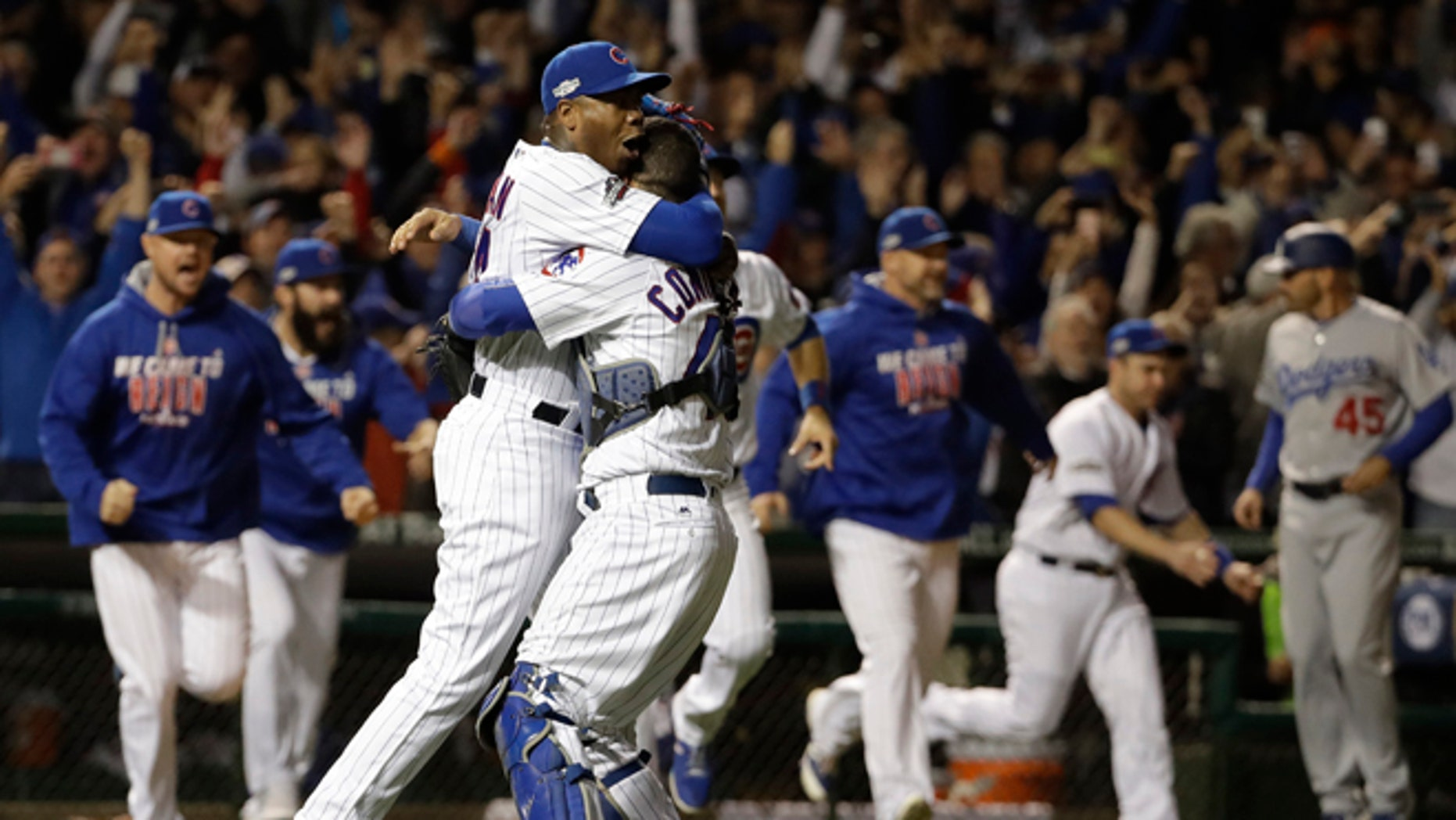 Chicago Cubs catcher Willson Contreras and relief pitcher Aroldis Chapman (54) celebrate after Game 6 of the National League baseball championship series against the Los Angeles Dodgers Saturday, Oct. 22, 2016, in Chicago. The Cubs won 5-0 to win the series and advance to the World Series against the Cleveland Indians. (AP Photo/David J. Phillip)