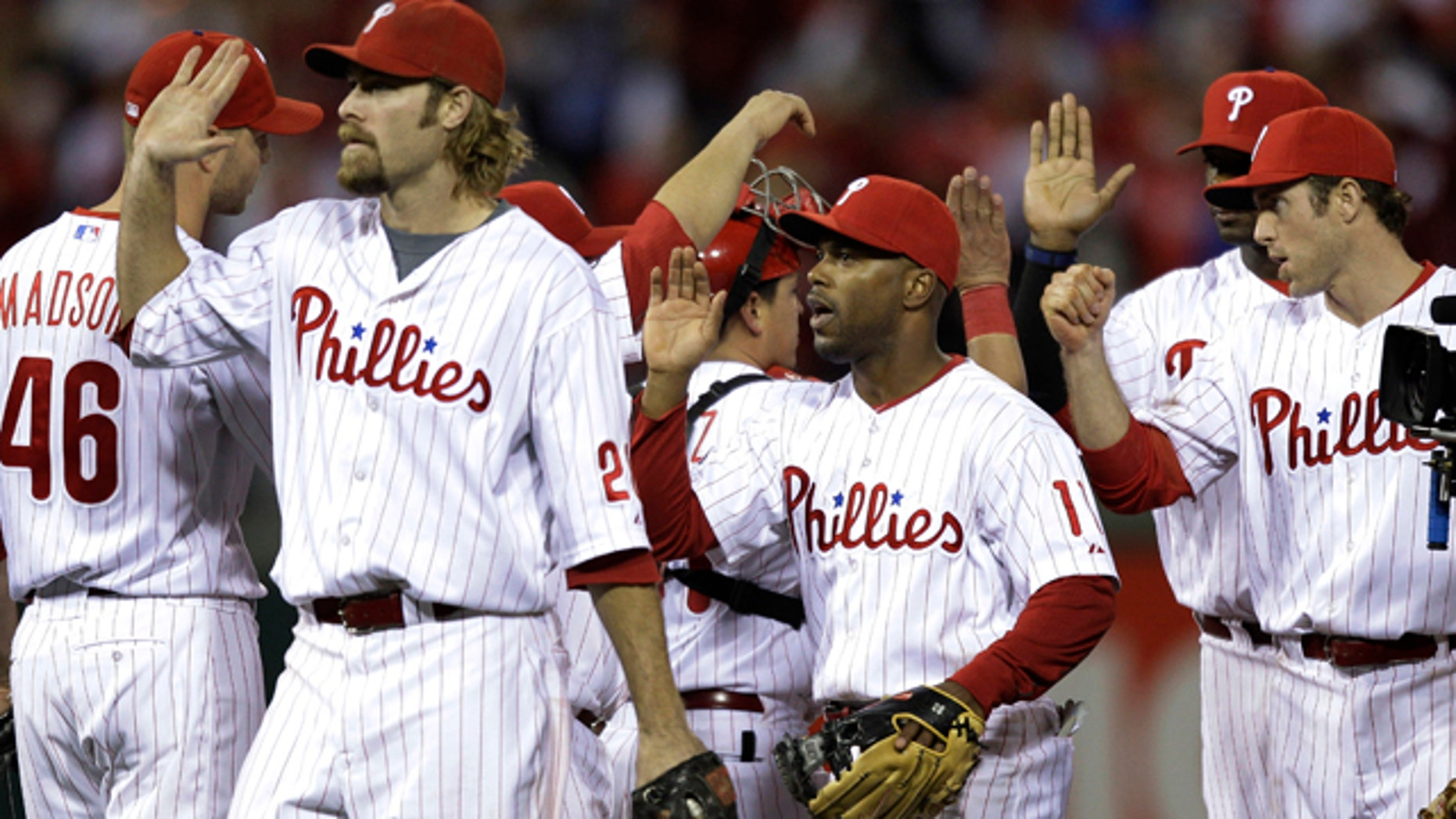 Oct. 17: The Philadelphia Phillies celebrate after winning Game 2 of the NLCS over the San Francisco Giants.