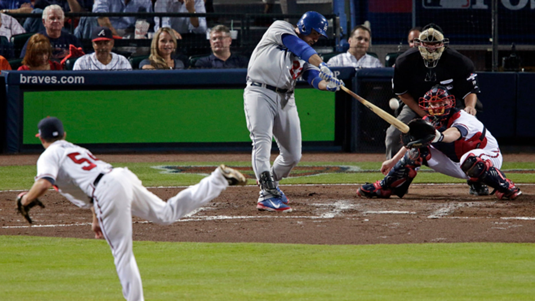 Los Angeles Dodgers Adrian Gonzalez (23) hits a two-run home run against the Atlanta Braves in the third inning of Game 1 of the National League Divisional Series, Thursday, Oct. 3, 2013, in Atlanta.  (AP Photo/Dave Martin)