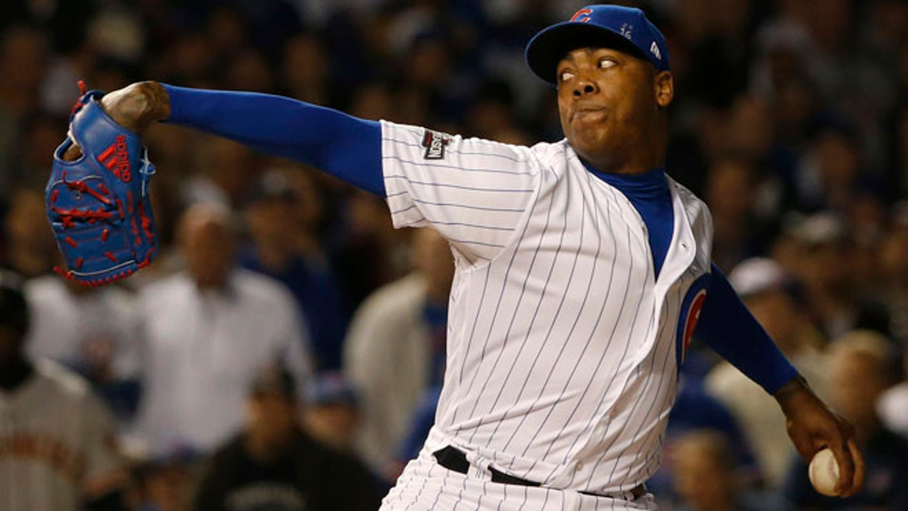 Chicago Cubs relief pitcher Aroldis Chapman (54) throws in the ninth inning of Game 2 of baseball's National League Division Series against the San Francisco Giants, Saturday, Oct. 8, 2016, in Chicago. (AP Photo/Nam Y. Huh)