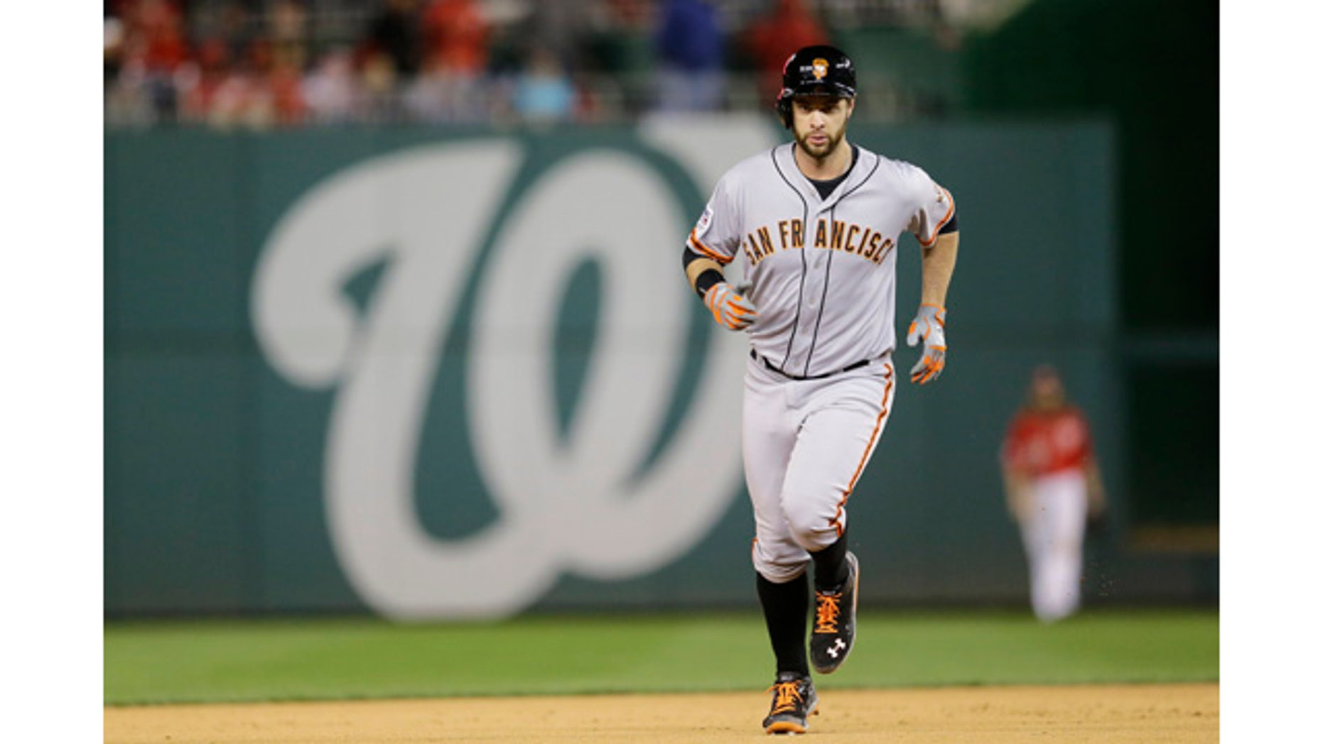 October 4, 2014: San Francisco Giants'; Brandon Belt runs the bases after hitting a solo home run in the 18th inning of Game 2 of baseball's NL Division Series against the Washington Nationals. (AP Photo/Patrick Semansky)