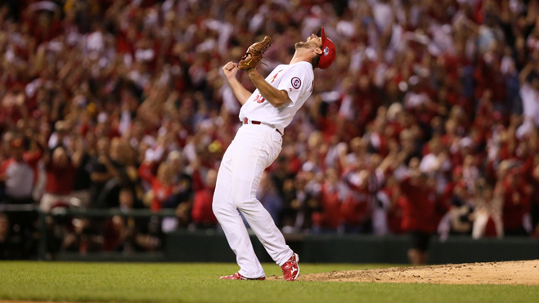St. Louis Cardinals starting pitcher Adam Wainwright reacts after throwing a complete game shut out during Game 5 of the National League Division Series between the St. Louis Cardinals and the Pittsburgh Pirates on Wednesday, Oct. 9, 2013, at Busch Stadium in St. Louis.  (AP Photo/post-dispatch.com, Chris Lee)