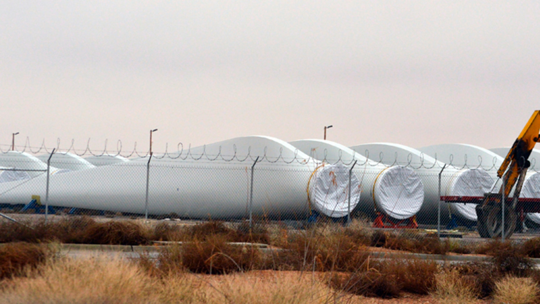 Blades for wind turbines sit in a field in the New Mexico town of Santa Teresa along the U.S.-Mexico border.