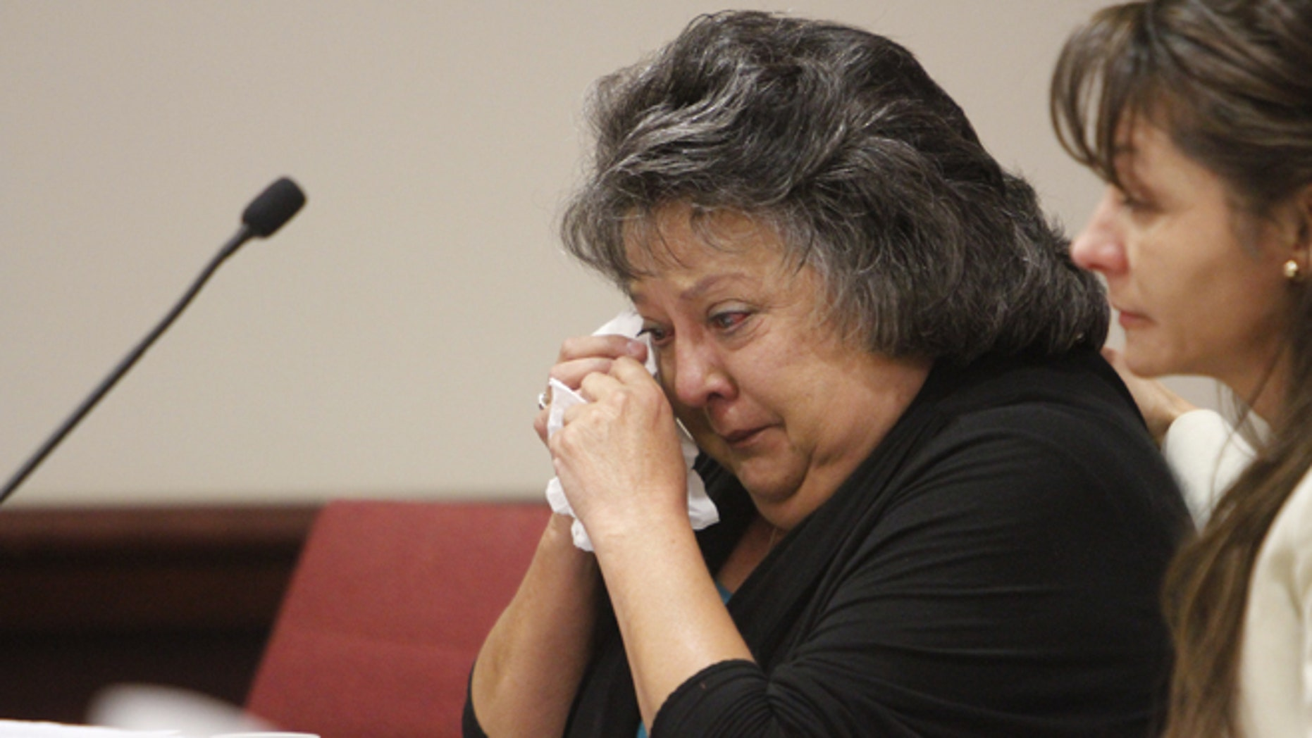 Former New Mexico Secretary of State Dianna Duran wipes away tears during her sentencing at Judge T. Glenn Ellington's district courtroom in Santa Fe, N.M., Monday, Dec. 14, 2015. Duran was sentenced to 30 days in jail for siphoning money from her election account to fuel a gambling addiction in a case that has led to calls for an overhaul of the stateâs campaign finance and ethics laws  (Luis Sanchez Saturno/Santa Fe New Mexican via AP) MANDATORY CREDIT