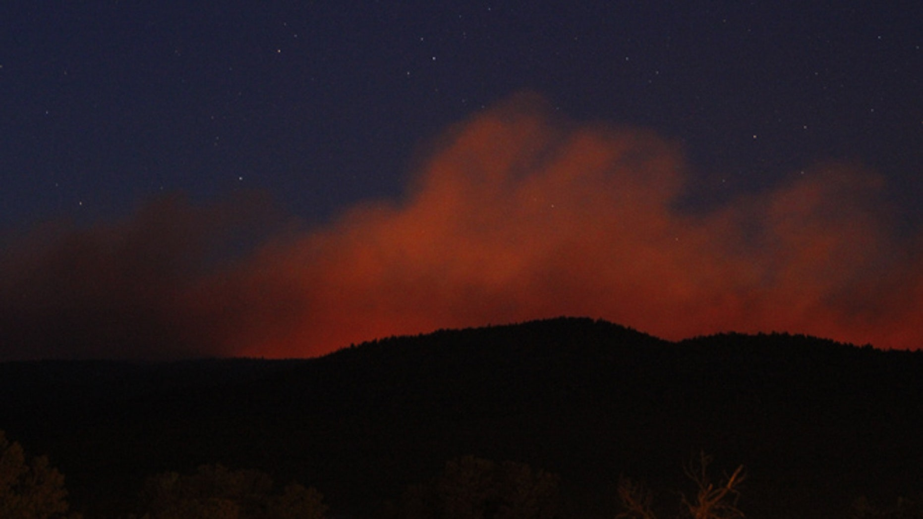 May 31, 2013: A view of the Tres Lagunas Fire from Pecos, N.M. Officials said the fire in New Mexico's Santa Fe National Forest more than doubled in size by Friday night and was still totally uncontained.