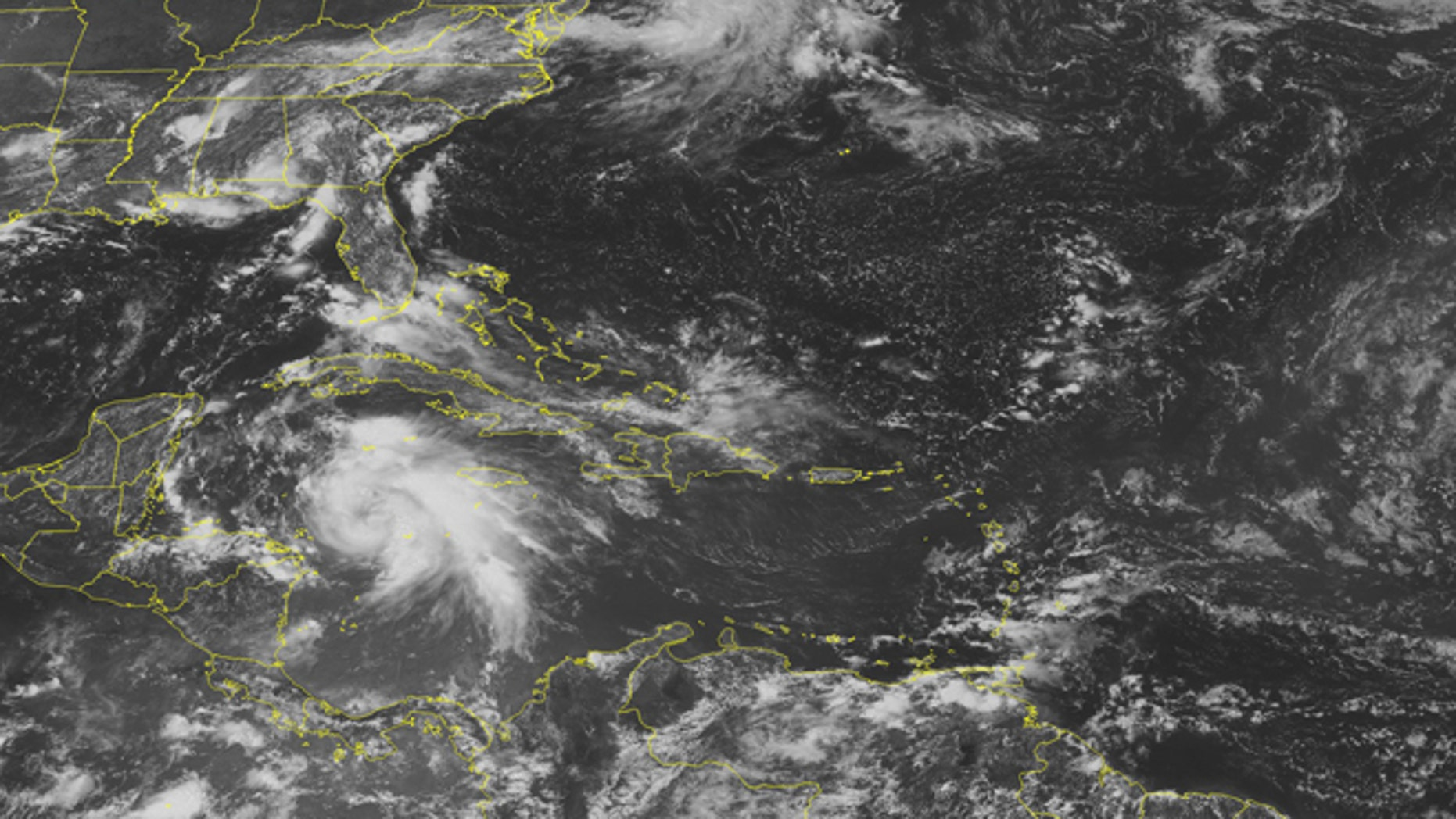 This NOAA satellite image taken Monday, Aug. 6, 2012 at 1:45 p.m. EDT shows a swirl of clouds in the western Caribbean Sea associated with Tropical Storm Ernesto as it moves toward the Yucatan Peninsula.  This storm is expected to strengthen into a hurricane later Monday before possibly making landfall in northern Belize Wednesday.  Ernesto could strengthen once it emerges in the Bay of Campeche. (AP Photo/Weather Underground)
