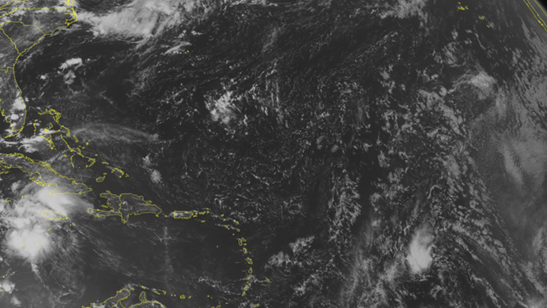 NOAA satellite image taken Tuesday, Aug. 2, 2016 at 12:45 PM EDT shows Tropical Storm Earl 210 miles south of Grand Cayman.