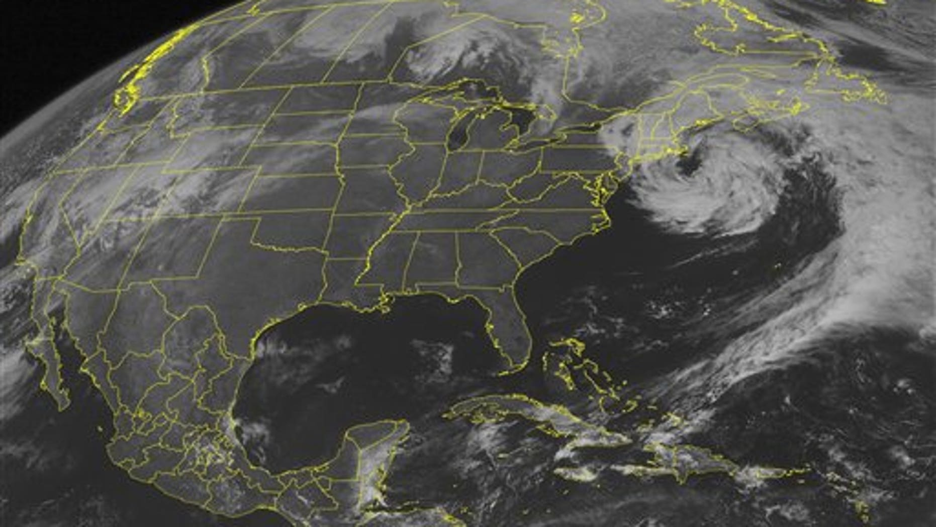March 31, 2010: This NOAA satellite image shows mid-level clouds swirling over the Northeast and curving into the western Atlantic Ocean as a weakening low pressure system remains off the New England coast.