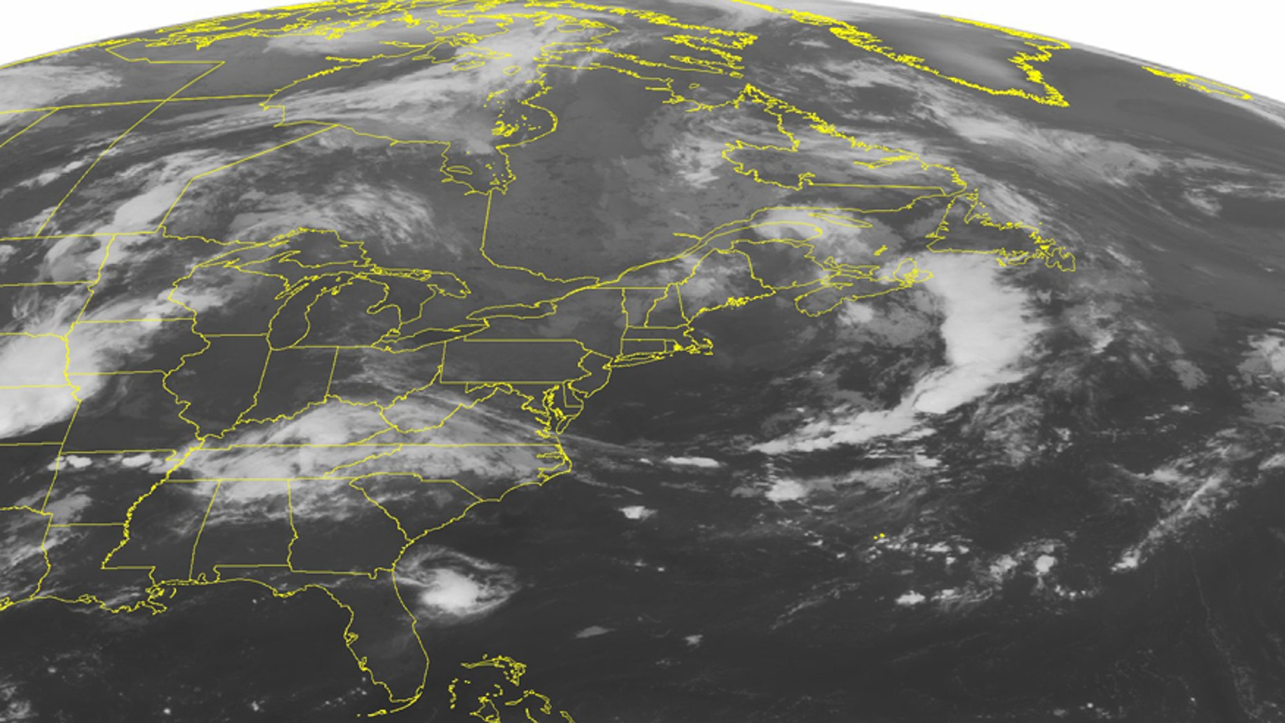 This NOAA satellite image taken Monday, Aug. 18, 2014 at 01:45 AM EDT shows a storm off the shore of northern New England that is extending a cold front into the Carolinas.