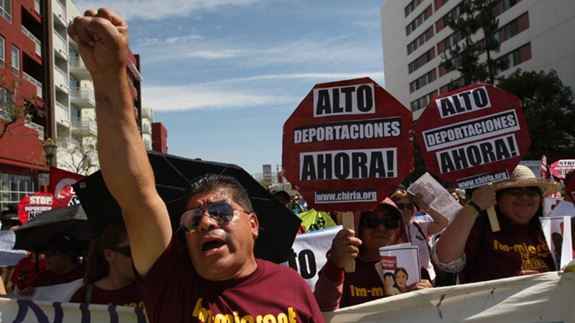 LOS ANGELES, CA - MAY 1:  People rally in one a several May Day immigration-themed events on May 1, 2014 in Los Angeles, California. Demonstrators are calling for immigration reform and an end to deportations of undocumented residents.  (Photo by David McNew/Getty Images)