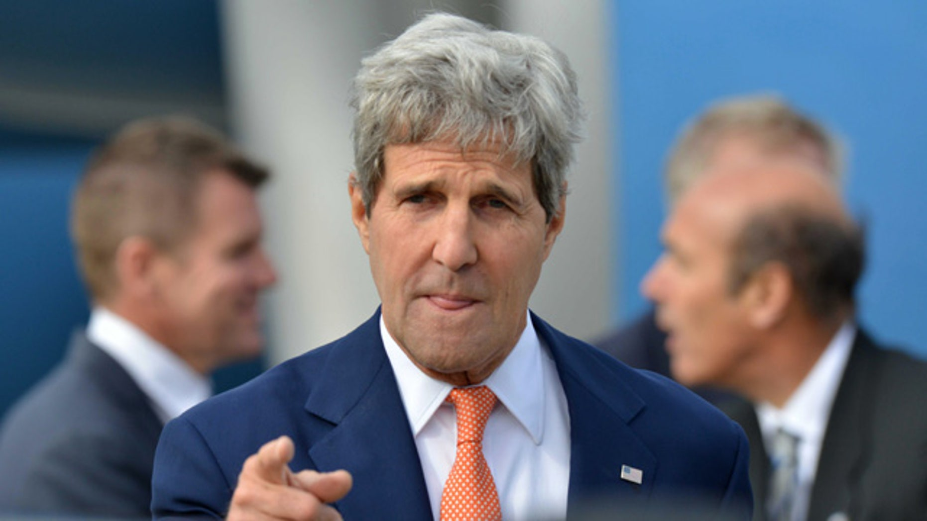 FILE - In this Monday, Aug. 11, 2014 file photo, U.S. Secretary of State John Kerry points a finger as he arrives in Sydney. In its latest personal attack on a prominent official, North Korea has called Kerry a wild dog with a 'hideous lantern jaw'. (AP Photo/Peter Parks, Pool)