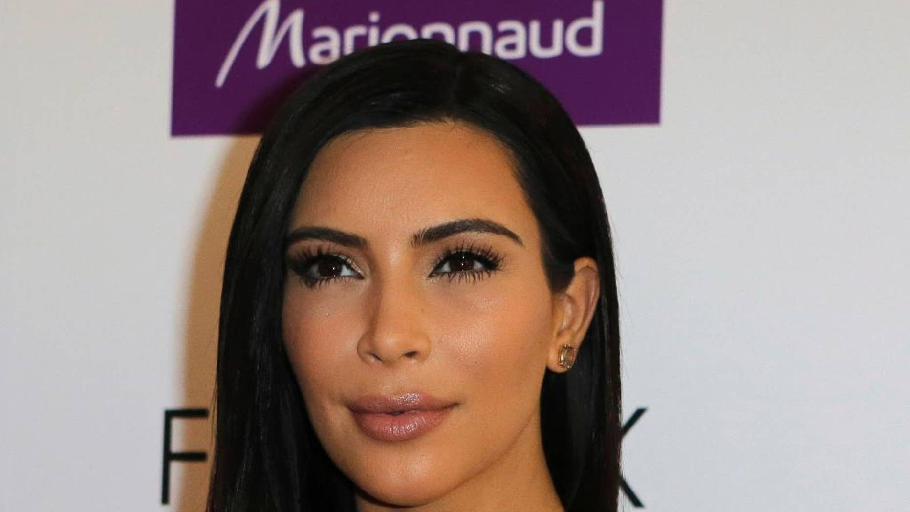 April 15, 2015. Kim Kardashian attends a photocall to launch hair products in Paris.