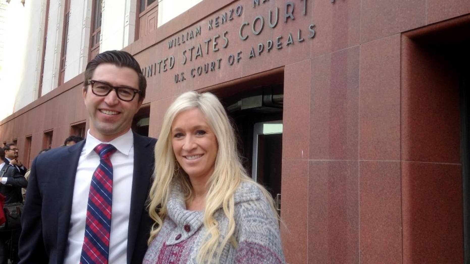 Idaho real estate attorney Peter Smith, left, and his wife, nurse Anna J. Smith, pose for a photo outside the federal appeals court building Monday, Dec. 8, 2014, in downtown Seattle. A three-judge panel of the 9th U.S. Circuit Court of Appeals heard arguments Monday in Anna Smith's case challenging the National Security Agency's bulk collection of Americans' phone records; Peter Smith argued the case on her behalf. (AP Photo/Gene Johnson)